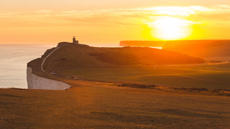 seven sisters: Panoramic view of Seven Sisters cliffs with lightouse and sea on background at sunset. Photo taken from Beachy Head, on Eastbourne side