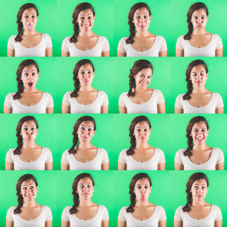 face expressions: Beautiful woman multiple portraits on green background. Each image is showing a different emotion like happiness, sadness, fear and some more.