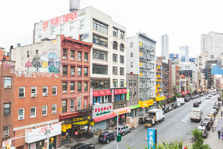 chinatown: NEW YORK, USA - AUGUST 23, 2014: View of a street and buildings in China Town district. All signs and writings are written with chinese characters. Editorial
