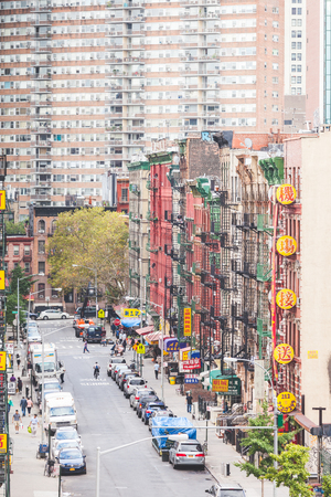 enclave: NEW YORK, USA - AUGUST 23, 2014: View of a street and buildings in China Town district. All signs and writings are written with chinese characters. Editorial