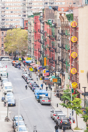 china town: NEW YORK, USA - AUGUST 23, 2014: View of a street and buildings in China Town district. All signs and writings are written with chinese characters. Editorial