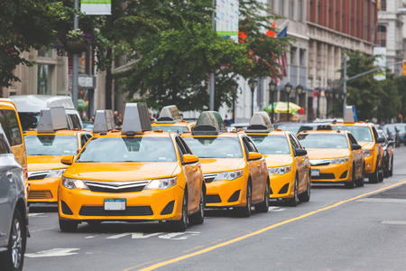 Typical yellow taxi in Manhattan street. Yellow cabs are a famous icon of New York city.
