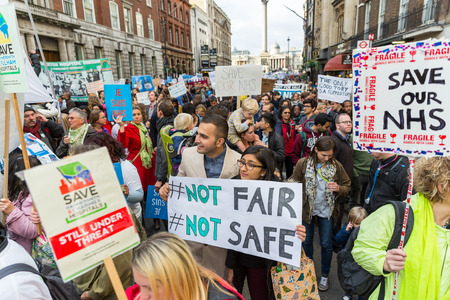 nhs: LONDON, UK - OCTOBER 17, 2015: Thousands Junior doctors marching in London streets to campaign against NHS contract changes