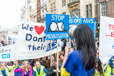 demonstration: LONDON, UK - OCTOBER 17, 2015: Thousands Junior doctors marching in London streets to campaign against NHS contract changes