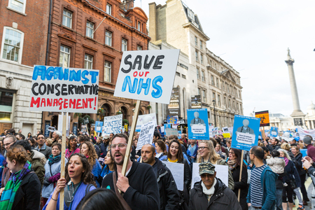 thousands: LONDON, UK - OCTOBER 17, 2015: Thousands Junior doctors marching in London streets to campaign against NHS contract changes