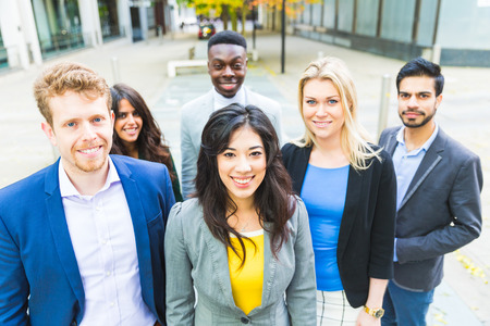 caucasian race: Business group looking at camera. They all are young, smiling and wearing smart casual clothes. Mixed race group, three women and three men. Teamwork and business concepts.