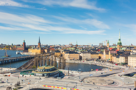 infrastructures: Stockholm, aerial view on a sunny day. Modern roads and infrastructures on foreground and historical landmarks on background. Typical Scandinavian architecture and colors. Travel and tourism concept. Stock Photo