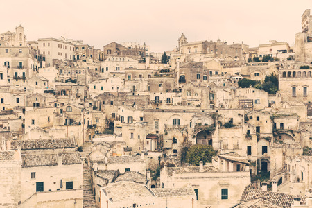 prehistorical: Old town of Matera, capital city of Basilicata county in Italy. It is famous worldwide for its sassi, typical houses with prehistorical origins. Architecture and travel concepts. Vintage filter added