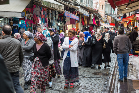 local 27: ISTANBUL, TURKEY - OCTOBER 27, 2014: People walking in the street and looking at local market shops. There are people with different ethnicities and wearing dirrent style of clothes
