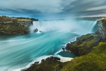 wide angle lens: Niagara Falls panoramic view at dusk. Long exposure with wide angle lens of the beautiful horse shoe fall at Niagara, from the Canadian side. Very famous and majestic destination