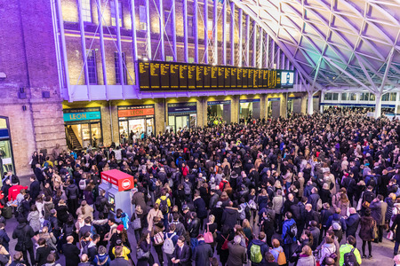 overcrowded: LONDON, UK - FEBRUARY 23, 2017: Crowded Kings Cross station in the city. Hundreds people waiting for the train, with delays and cancellations as Storm Doris lashes UK