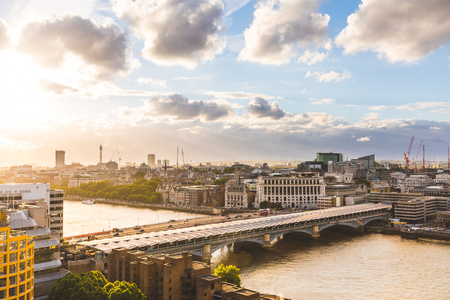 blackfriars bridge: London at sunset, aerial view. Panoramic image of London with Blackfriars bridge and Thames river on foreground, and the city on background. Travel and architecture concepts Editorial