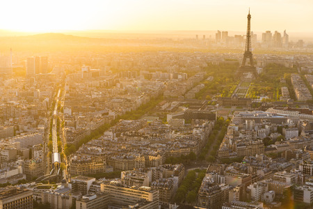 Aerial view of Paris with Eiffel Tower on background. Panoramic view of the city at sunset, golden natural effect. Travel and architecture concepts Stock fotó