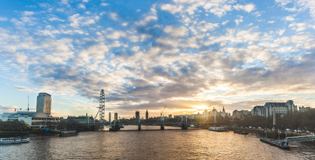 London panoramic view at sunset with Big Ben on background. Photo taken from Waterloo bridge, with some of the most famous landmarks in London, Big Ben is in the middle. Travel and architecture concepts