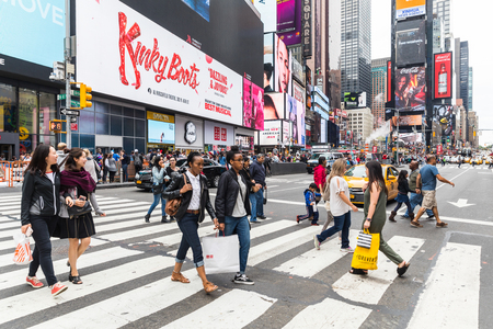 NEW YORK, USA - SEPTEMBER 2, 2017: Times Square crowded with tourists and commuters. People crossing the street on pedestrian crossing
