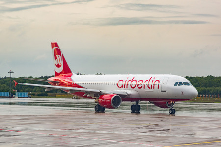 COLOGNE, GERMANY - MAY 12, 2014: Airberlin Airbus A320 at Cologne-Bonn Airport taxiing in the runaway. The company has filed for bankruptcy and will cease operations on 28th October 2017.