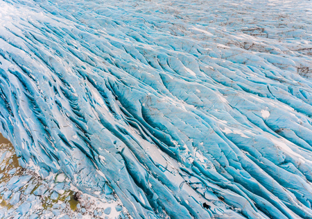 Glacier with blue ice aerial view in Iceland. Beautiful view of a glacier in the Vatnajokull area. Nature and textures. Stock Photo