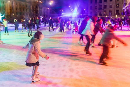 MUNICH, GERMANY - DECEMBER 11, 2016: People ice skating in Karlsplatz. On Christmas time a large ice rink is available during day and evening in the famous square of the city Editorial