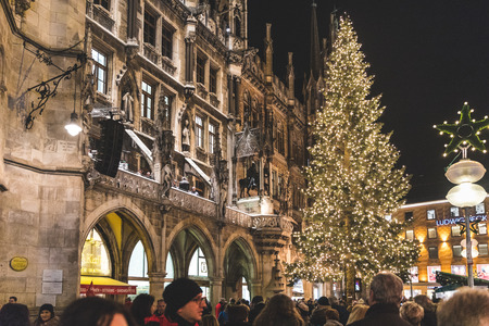 MUNICH, GERMANY - DECEMBER 13, 2016: Christmas tree in Marienplatz, in front of the Rathaus, with people enjoying Christmas markets and shopping. Editorial