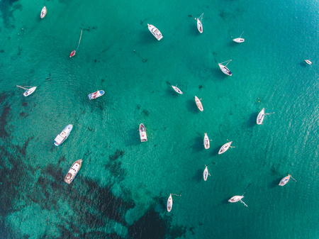 Beautiful aerial view of boats and emerald water in southern Italy. View from above of sails and boats anchored in a tourist harbour. Travel and nature concepts. Reklamní fotografie - 94773071