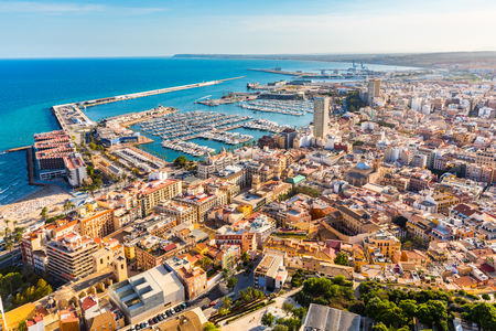 Alicante city panoramic aerial view with seaside, harbour and houses. Spanish city with beautiful beach. Travel and holidays concepts with a popular European summer destination.