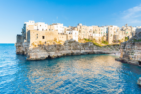 Polignano a Mare, beautiful and historical town on the seaside in Apulia region, southern Italy. White houses and buildings on top of a cliff overlooking the blue sea. Travel, architecture concepts Reklamní fotografie