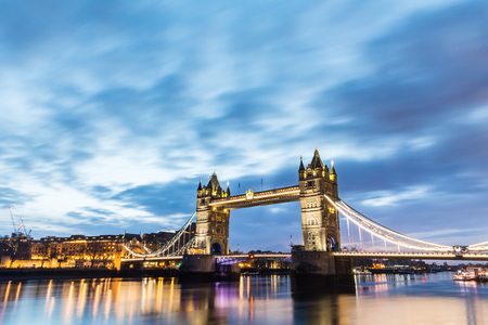 London, Tower Bridge beautiful view at sunrise. Long exposure shot in London with a great view on Thames river, Tower of London and Tower Bridge, with blurred clouds on top. Reklamní fotografie - 101521110