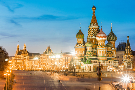 Moscow cityscape with St Basils Cathedral and Red Square buildings. Night view of the famous church in the capital city of Russia. Long exposure photo in Moscow after sunset. Travel and architecture