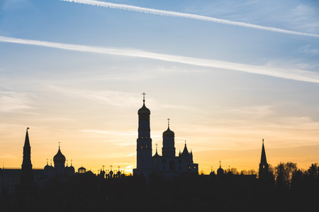 Kremlin silhouette view at sunset in Moscow, Russia. Dormition orthodox cathedral in the middle with other bell towers and towers on the sides. Architecture and travel concepts Stock fotó