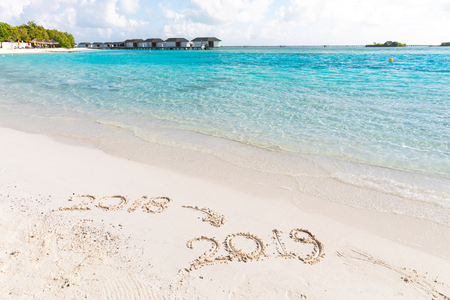 2019 writing on the sand new year sign best wishes for a happy new