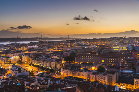 Lisbon panoramic view at dusk. Beautiful and colourful warm view of the capital city of Portugal with lights turned on. Travel and architecture concepts