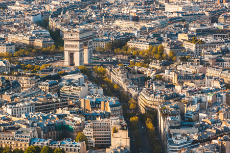 Arc de Triomphe in Paris aerial panoramic view. Birds eye view of the French Triumphal arch with buildings all around. Travel and architecture concepts in France capital city. Zdjęcie Seryjne