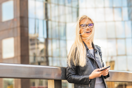 Happy woman portrait with modern buildings on background - Laughing smiling beautiful blonde woman in London financial district - Lifestyle and business concepts in capital city