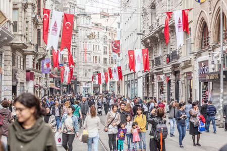 ISTANBUL, TURKEY - OCTOBER 26, 2014: Crowded Istiklal street on a Sunday morning. Turkish flags for the Republic Day celebrations that will take place on October 29 Editorial