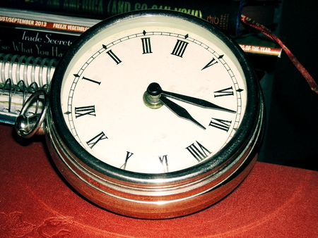 Metal clock with roman numerals