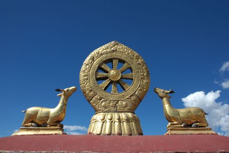holy symbol: holy symbol on Tibetan temple roof  Stock Photo