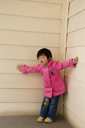 Asian child peeking photo