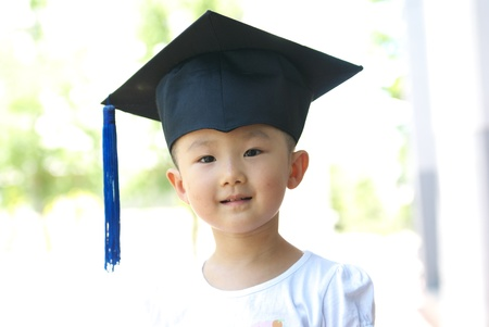 Asian child in graduation gown photo