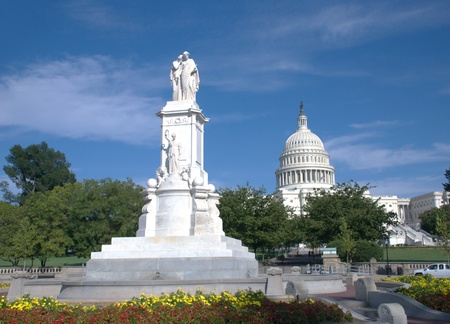statue and Capitol in Washington DC photo