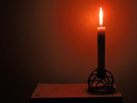 Lighting a candle in the darkness of night.
