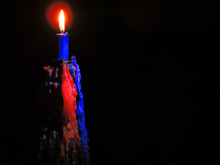 luminaire: Lighting a candle in the darkness of night.