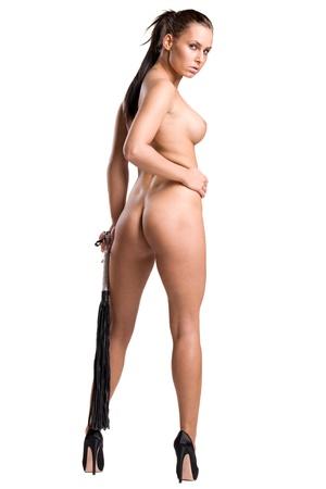 girl sexy nude: chica desnuda muy sexy con un l�tigo en sus manos aisladas sobre fondo blanco Foto de archivo