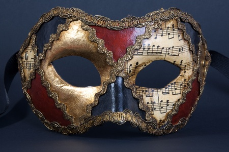 beautiful handmade venetian mask on dark blue background photo