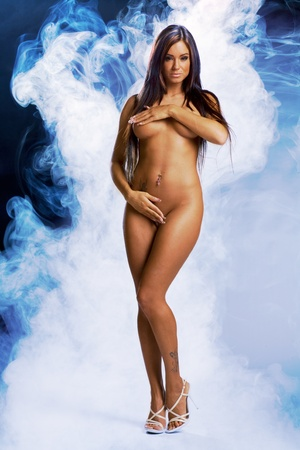 beautiful sexy naked girl covered in blue light and smoke