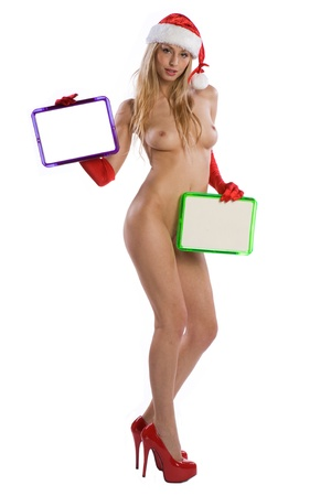 sexy nude christmas girl holding a white board or sign in her hands on witch you can write your text photo