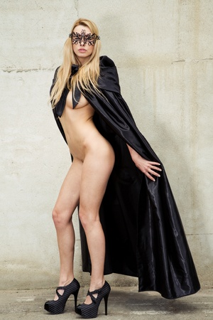 natural nude beauty wearing a gothic cape and her eyes are covered with a mask and black high heels Stock Photo - 9826185