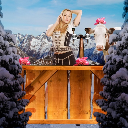 very beautiful tiroler ski girl in the snow behind a bar Stock Photo - 9997853