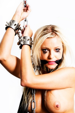 bondage art style with blond dirty woman cuffed in chains en gagged with silk scarf Stock Photo - 10039367