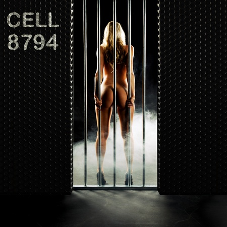beautiful nude woman locked in a prison cell Stock Photo - 10765748