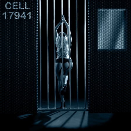 beautiful woman in black lingerie locked in a prison cell Stock Photo - 10765746